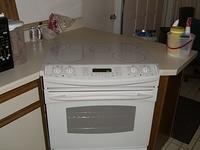 New GE Electric stove in place and ready to use.  Man this thing is so much easier to clean then the gas stove was.
